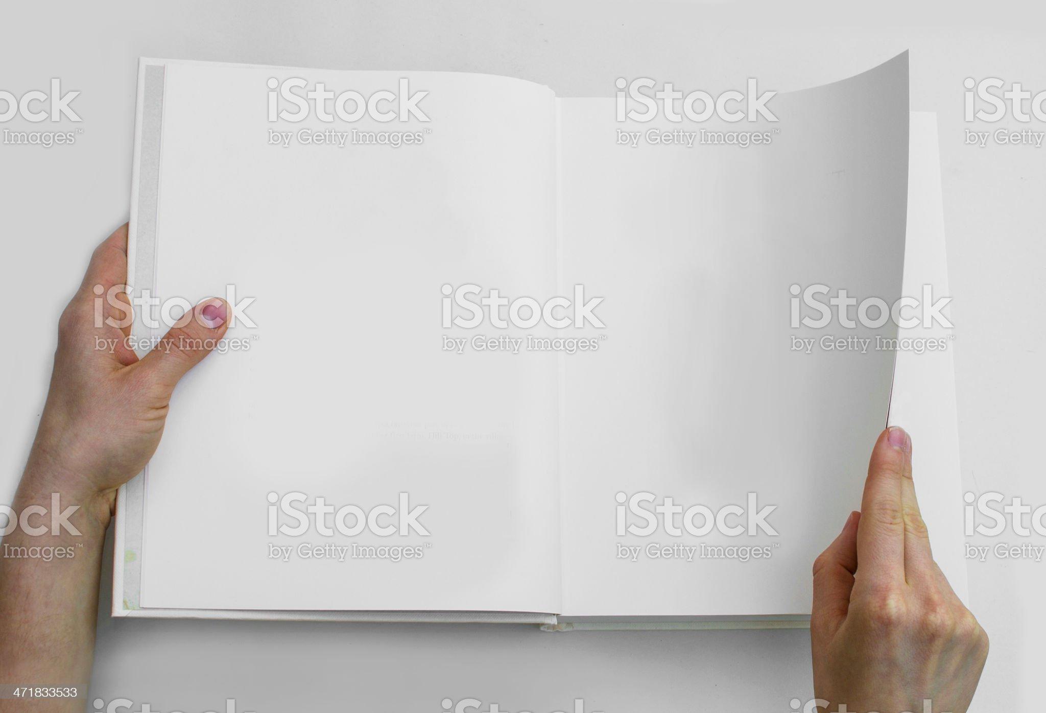 Thumbing through a book royalty-free stock photo