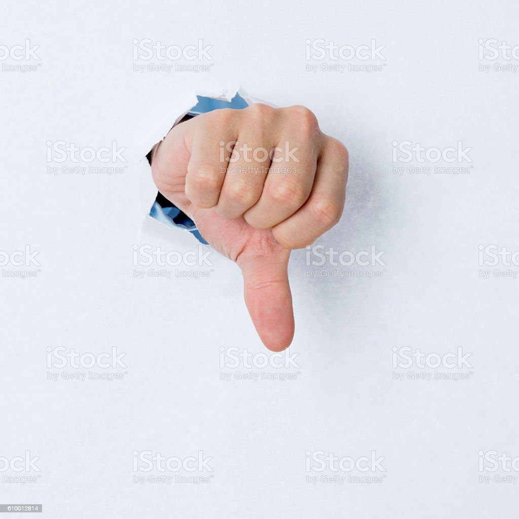 Thumbs down from tearing paper stock photo