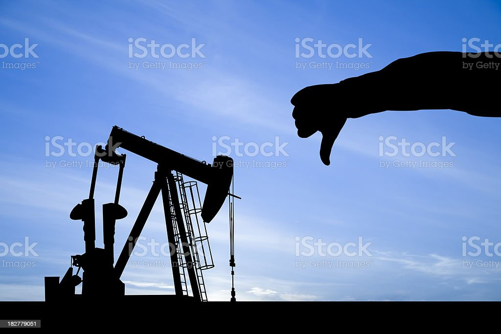 Thumbs down on the Oil Industry stock photo