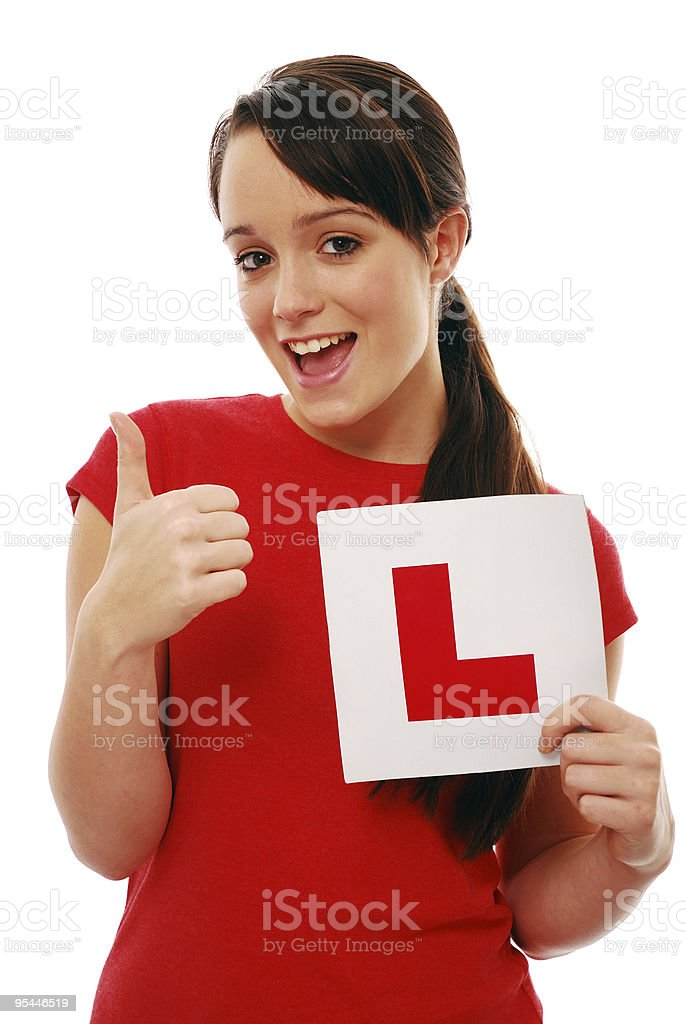 Thumbs up after passing driving test royalty-free stock photo