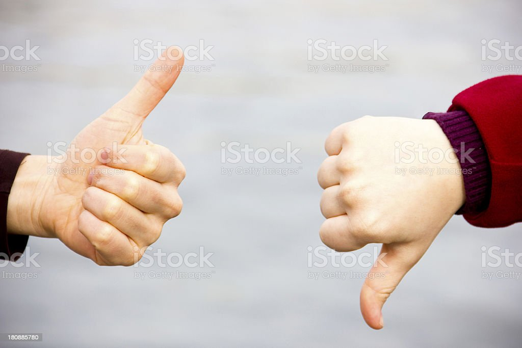 Thumbs up and down royalty-free stock photo