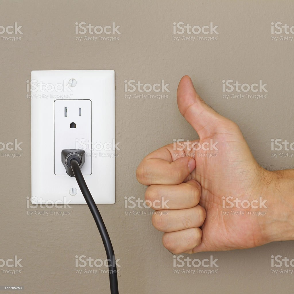 Thumbs up and Electric cable royalty-free stock photo