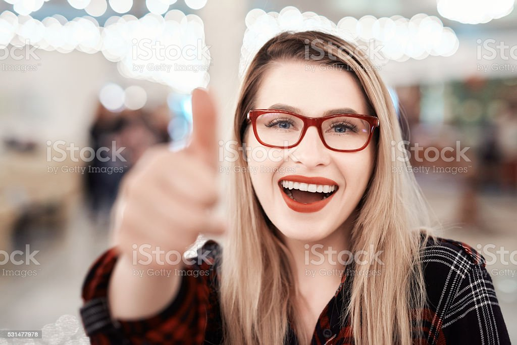 thumbs up and smile stock photo