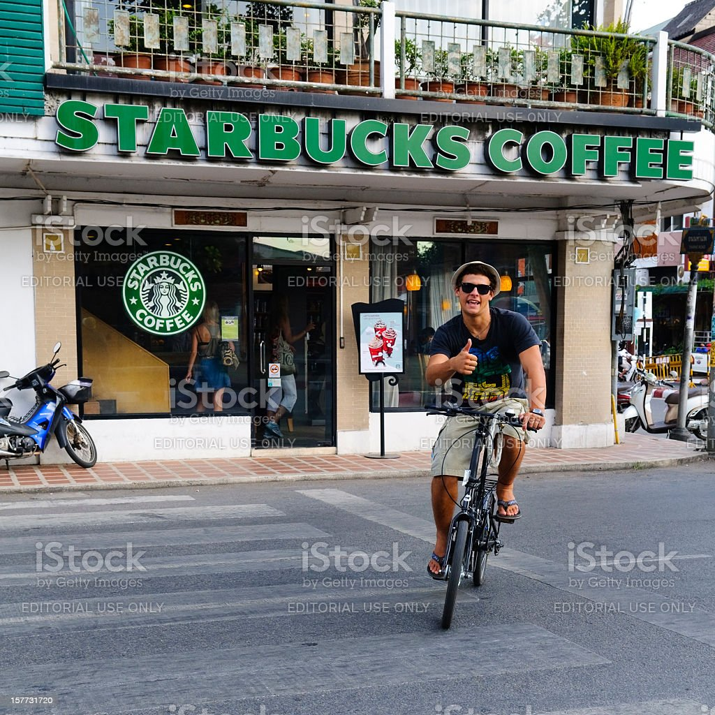 Thumbs up at Starbucks in Chiang Mai, Thailand royalty-free stock photo