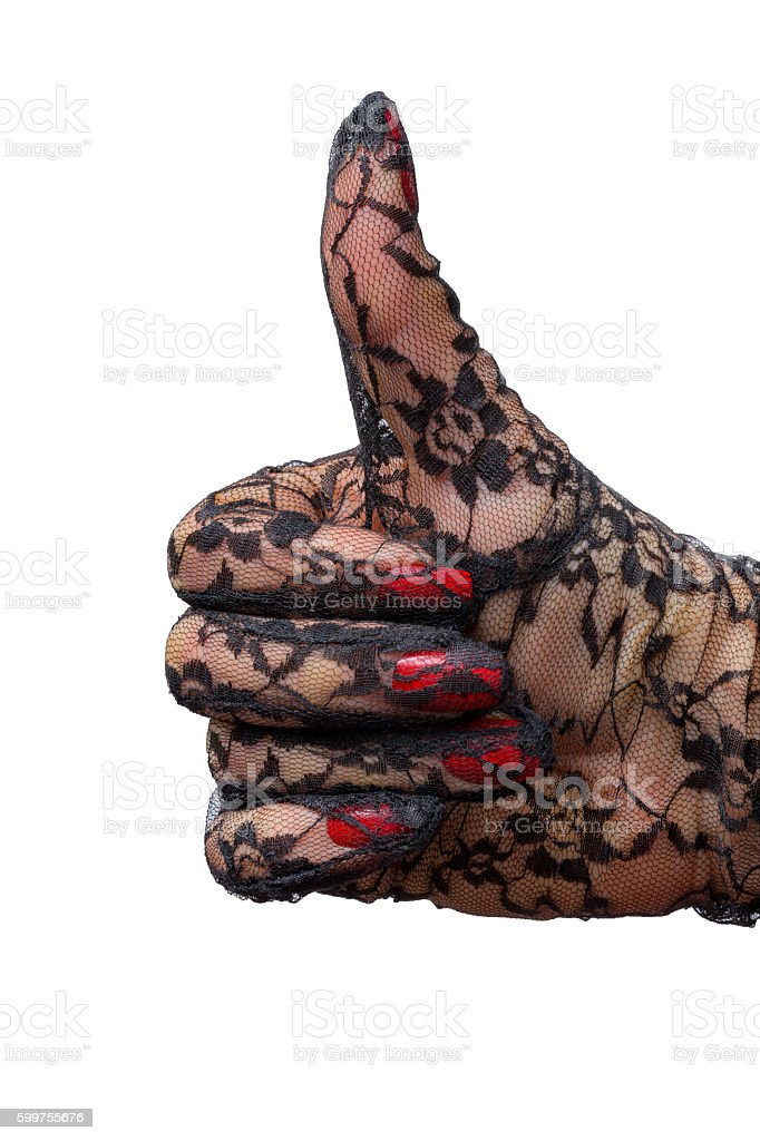Thumbs up, close up hand  female in lace evening glove stock photo
