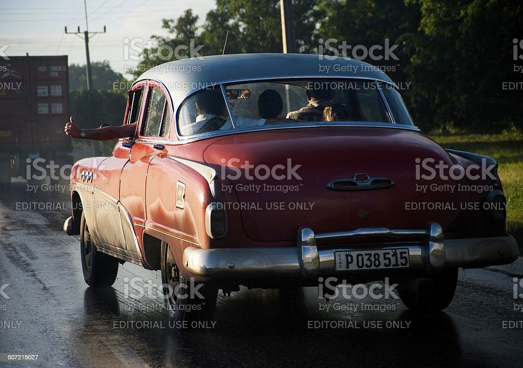 Thumbs up driver in vintage Cuban car stock photo