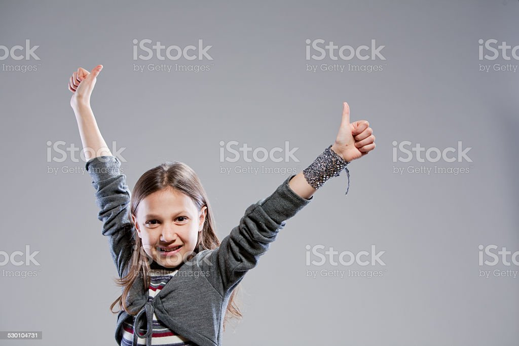 thumbs up everybody says the girl stock photo