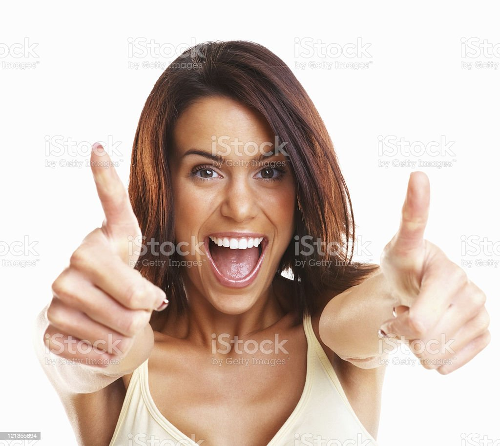 Thumbs up - Excited young girl wishing you good luck stock photo
