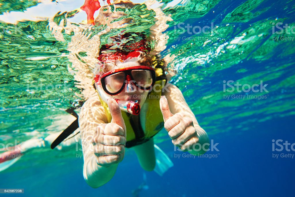 thumbs up for scuba diving stock photo