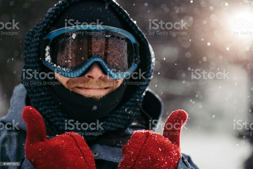 Thumbs up for winter holidays stock photo