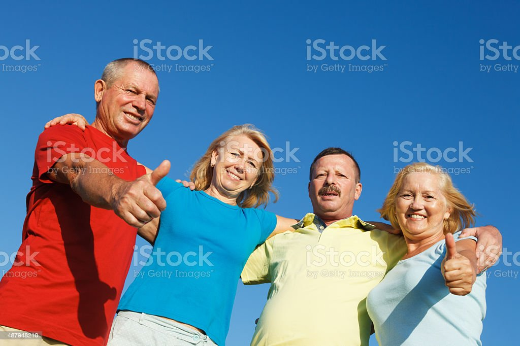 Thumbs Up Friends. stock photo