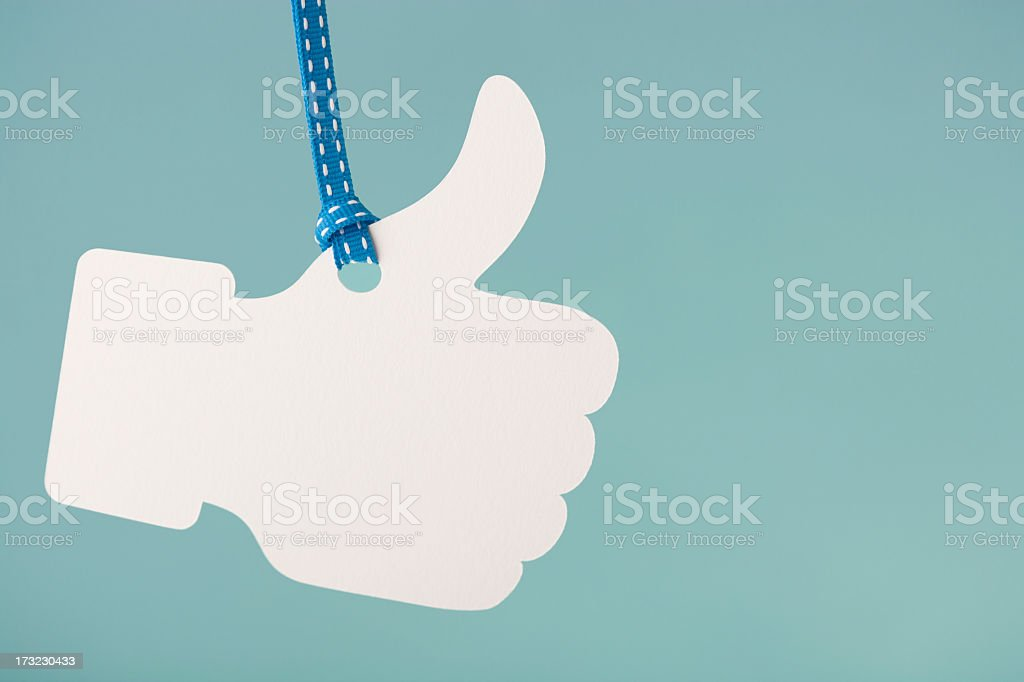 Thumbs up  hanging from cord royalty-free stock photo