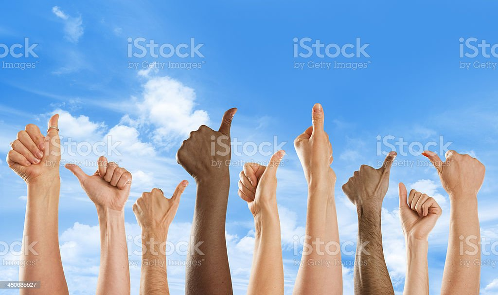 Thumbs up in approval from mixed nationalities royalty-free stock photo