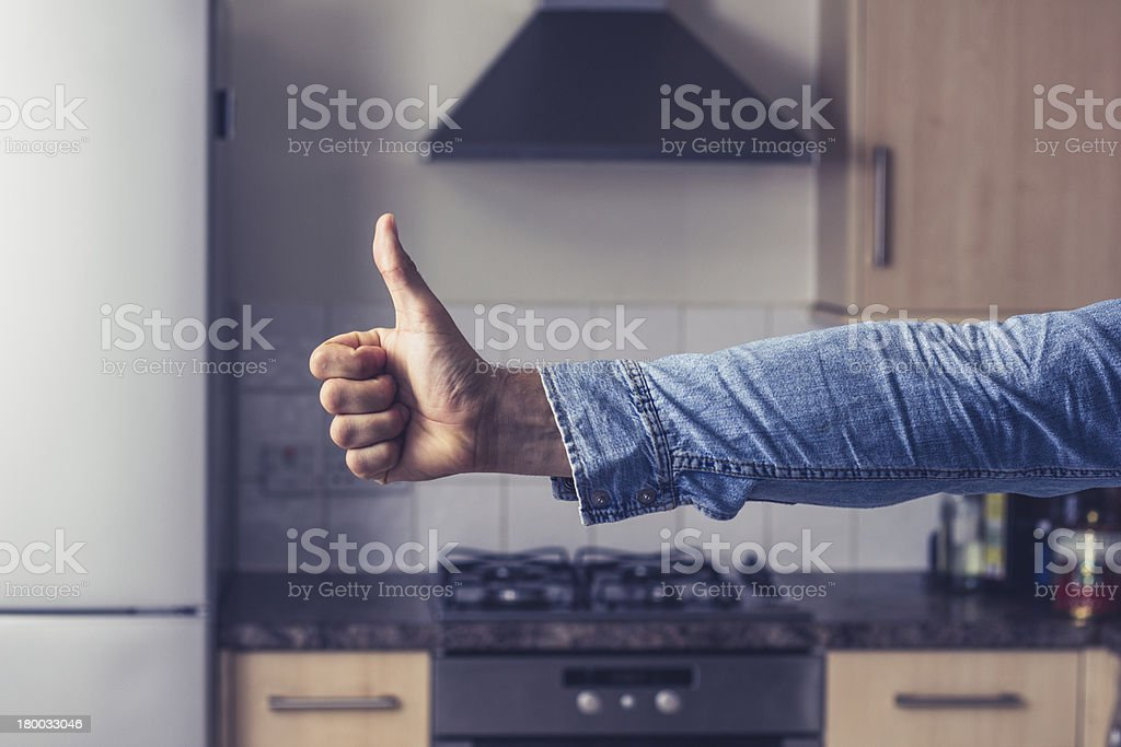Thumbs up in clean and tidy kitchen royalty-free stock photo