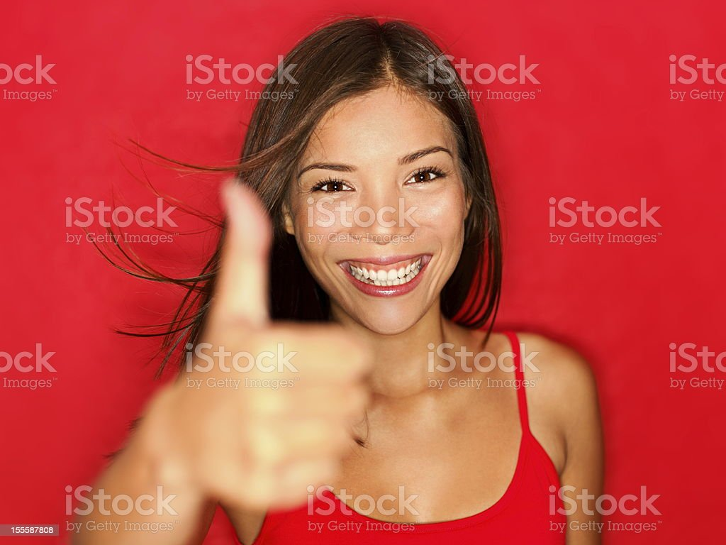 Thumbs up like woman happy royalty-free stock photo