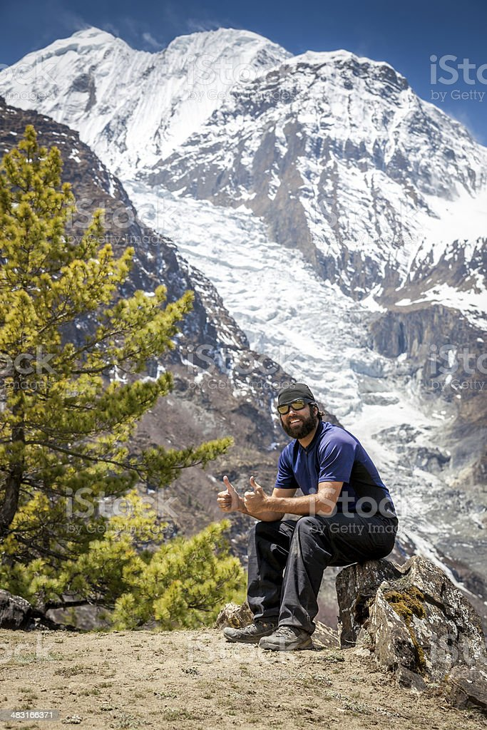 Thumbs Up Man Hiker in Annapurna trek, Nepal royalty-free stock photo