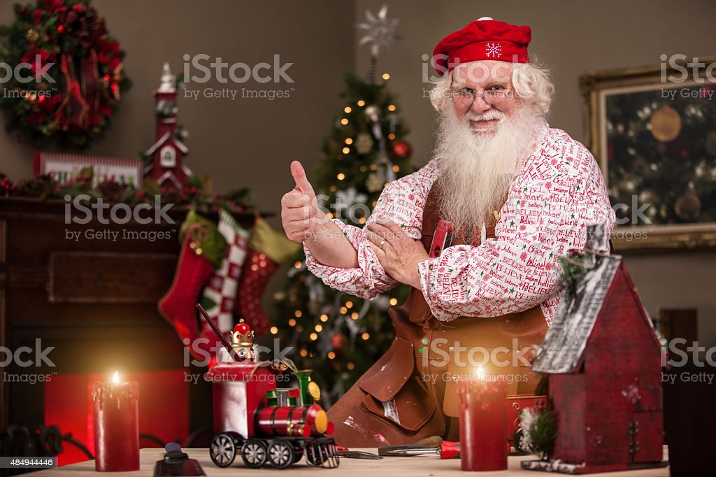 Thumbs Up Santa in Toy Shop stock photo