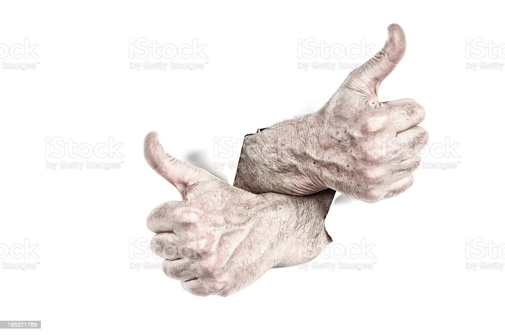 Thumbs Up Tearing Hole royalty-free stock photo