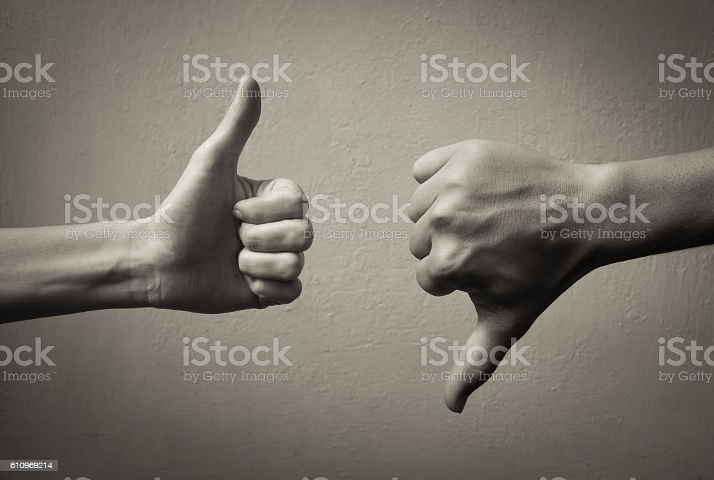 Thumbs up thumbs down. stock photo