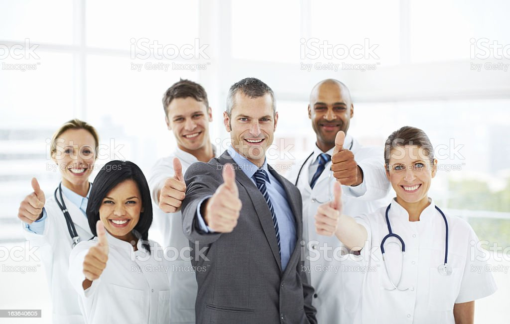 Thumb's up to excellent healthcare royalty-free stock photo