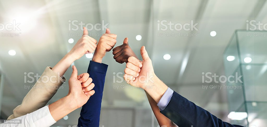 Thumbs up to success! stock photo