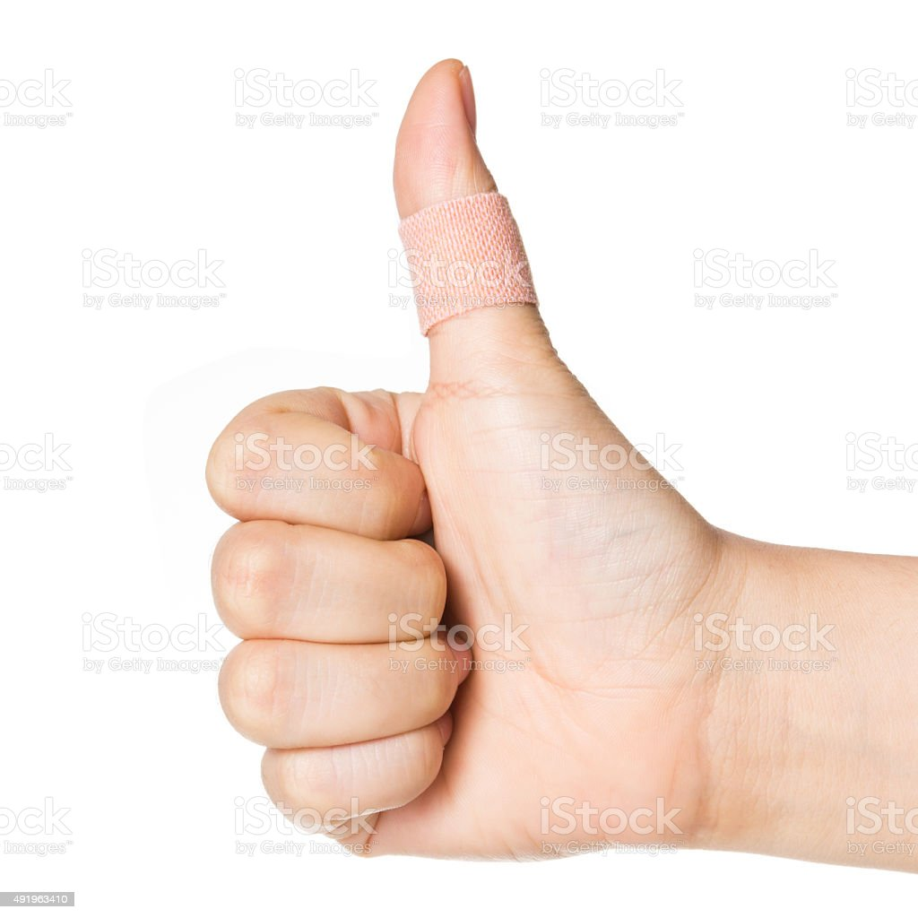 thumbs up with plaster bandage isolated on white. stock photo