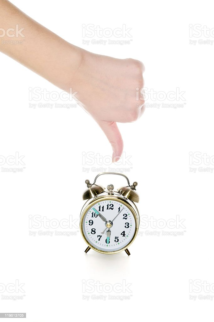 thumbs-down and alarm clock stock photo