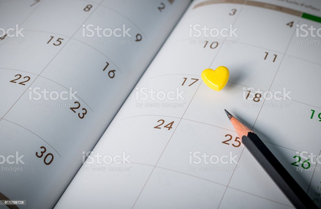 Thumbtack in calendar concept for busy, appointment and meeting stock photo