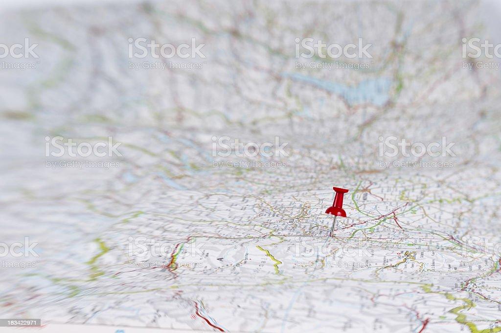 thumbtack on huge map stock photo