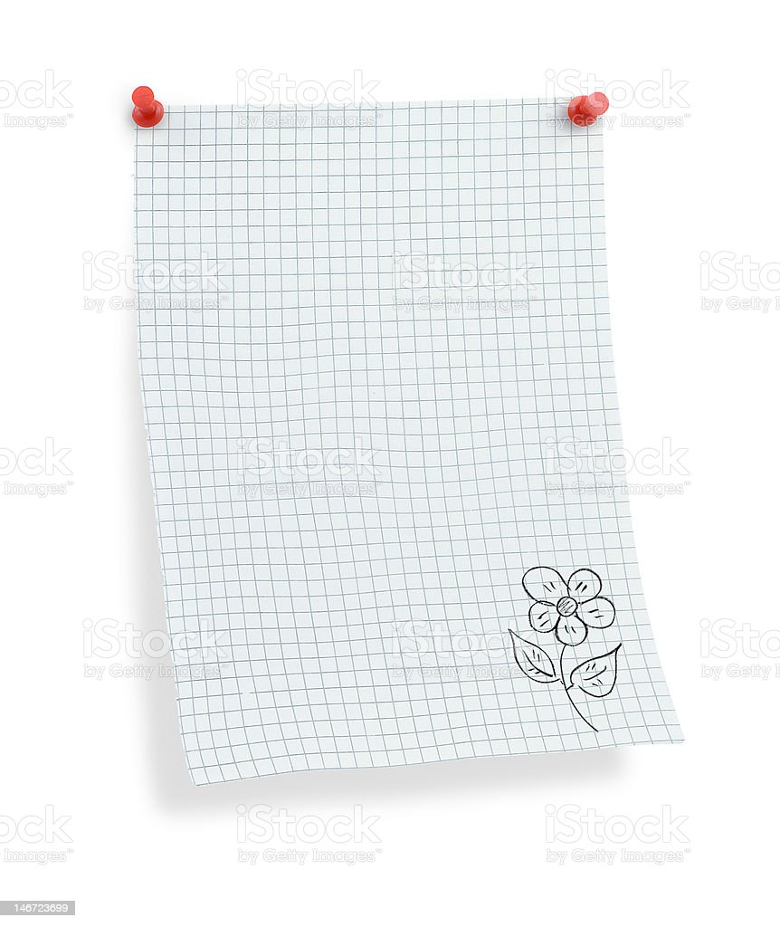 thumbtacked squared paper with flower motif stock photo