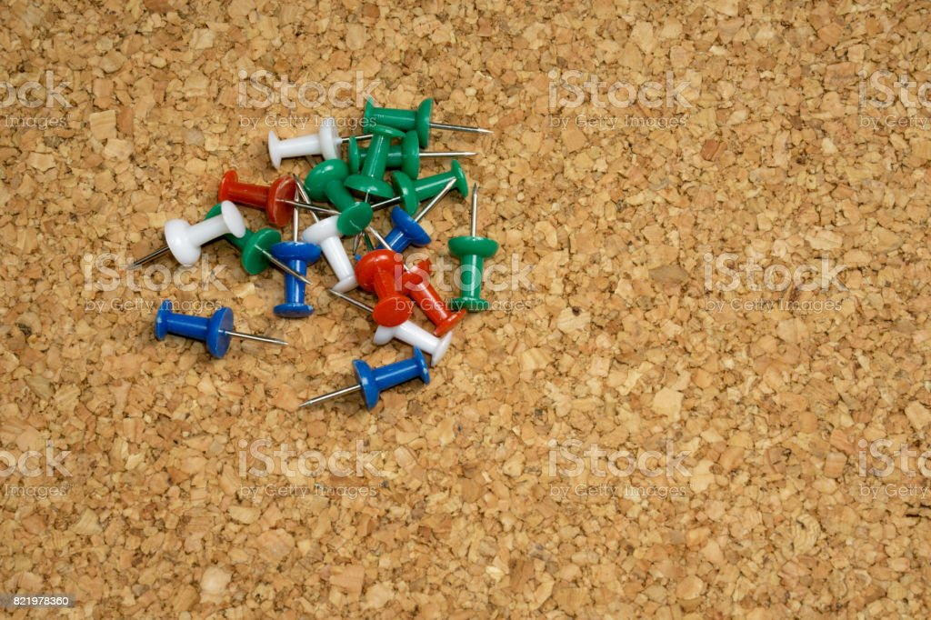 Thumbtacks, drawing pins on cork board stock photo