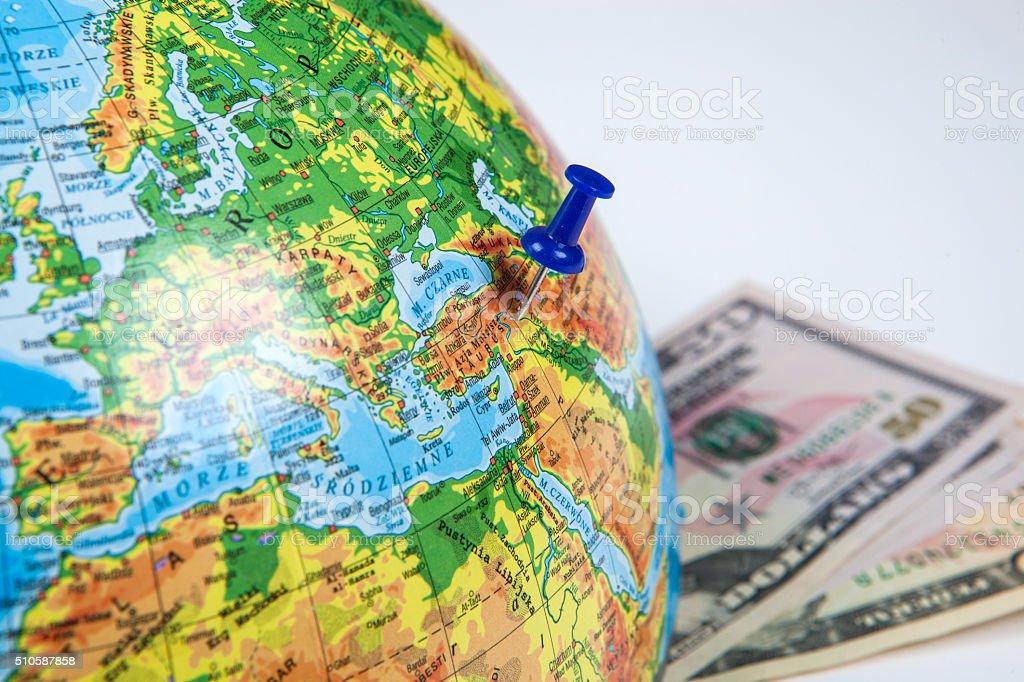 Thumbtacks on globe stock photo
