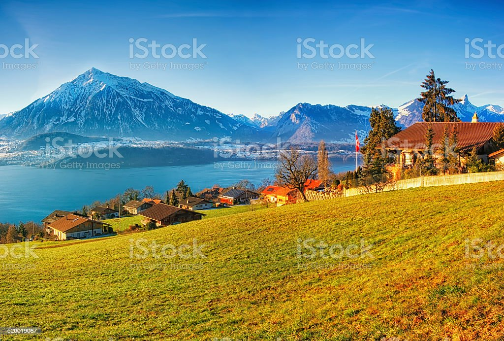 Thun lake region rural view in winter morning sunrise stock photo