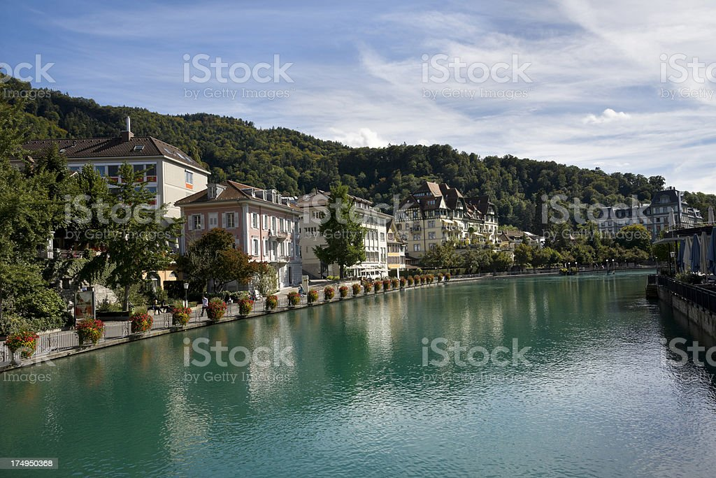 Thun, Switzerland. Swiss Houses along the banks of Aare River royalty-free stock photo