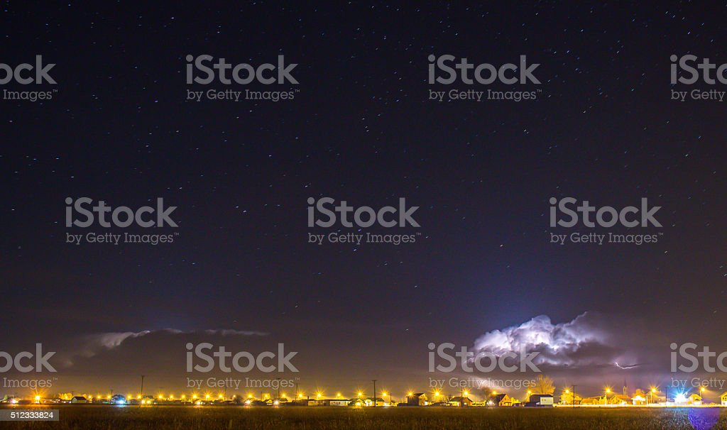 Thunder Cloud over the village and lightning coming out stock photo