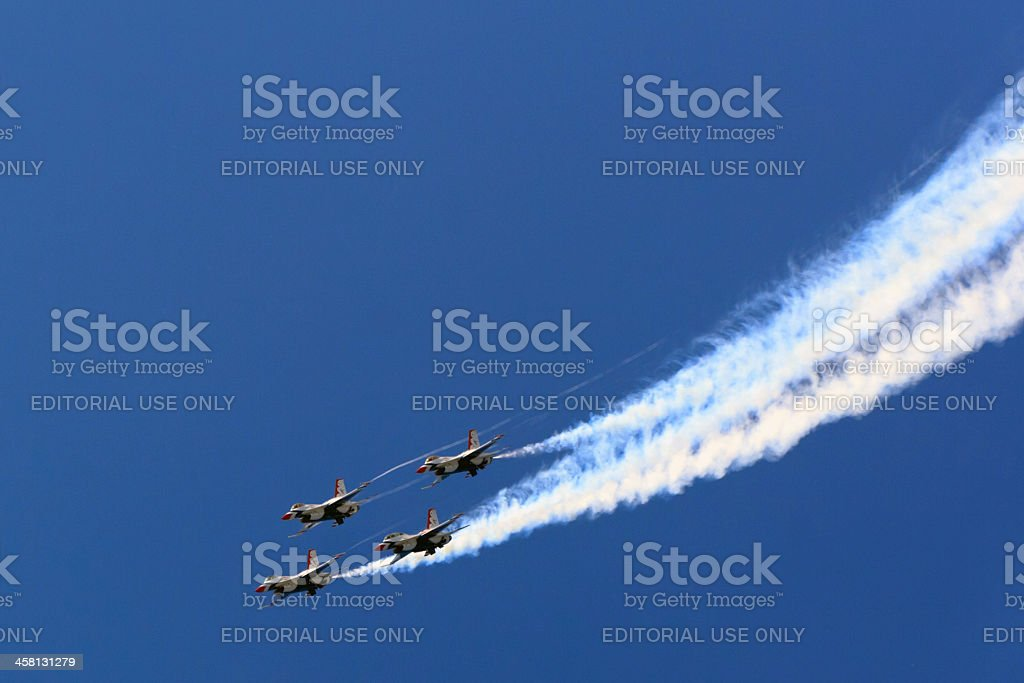 Thunderbirds diving with white smoke contrails royalty-free stock photo