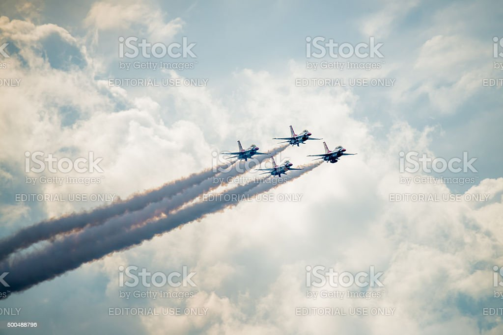 USAF Thunderbirds Flying above the Clouds stock photo