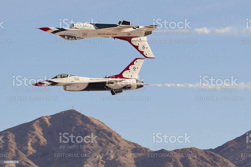 USAF Thunderbirds performing mirror pass royalty-free stock photo