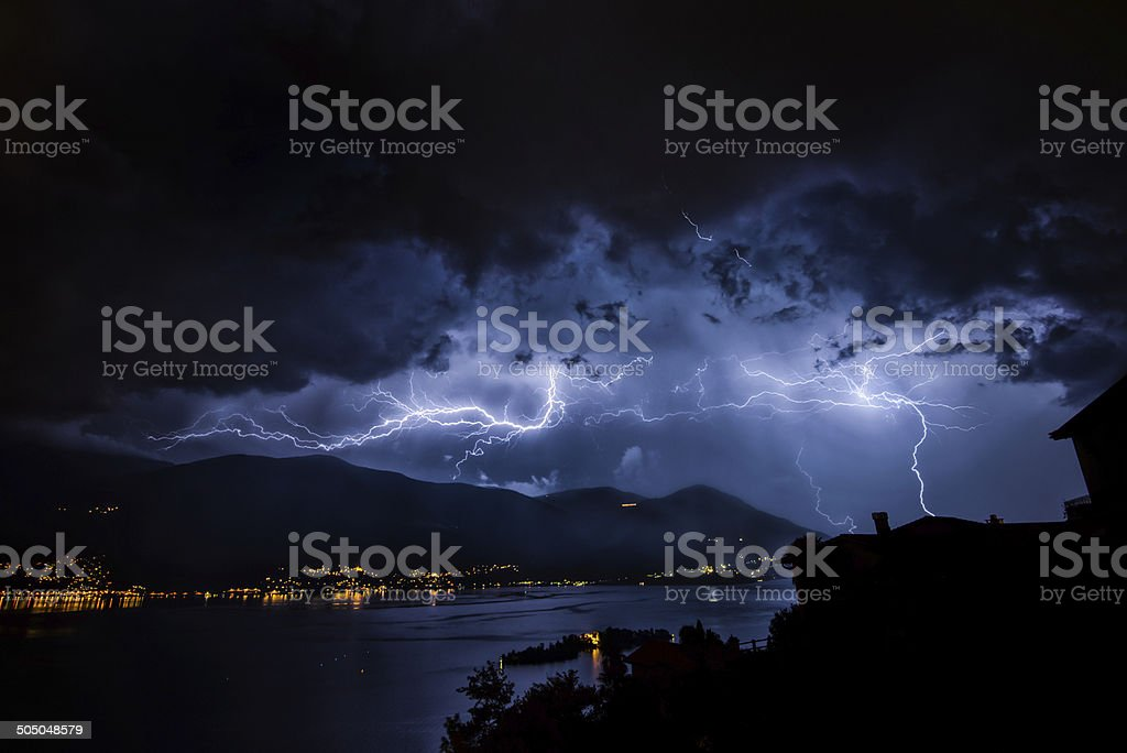 Thunderbolt and lihgtning over Lago Maggiore with isole di Brissage royalty-free stock photo