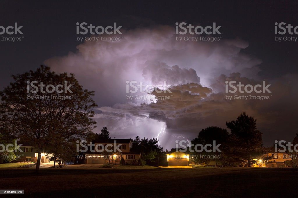 Thunderhead lightning strikes over Denver homes Colorado stock photo