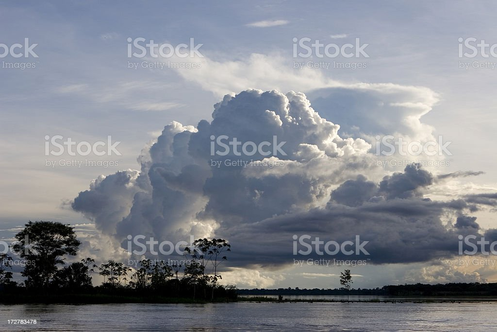 Thunderheads build over the Amazon river and rainforest stock photo