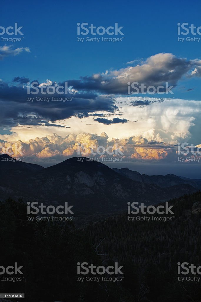 Thunderstorm clouds above Rocky Mountains at sunset royalty-free stock photo