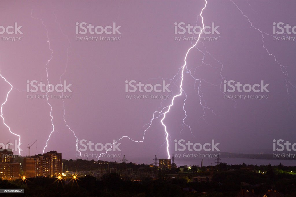 Thunderstorm in the city. lightning bolt stock photo