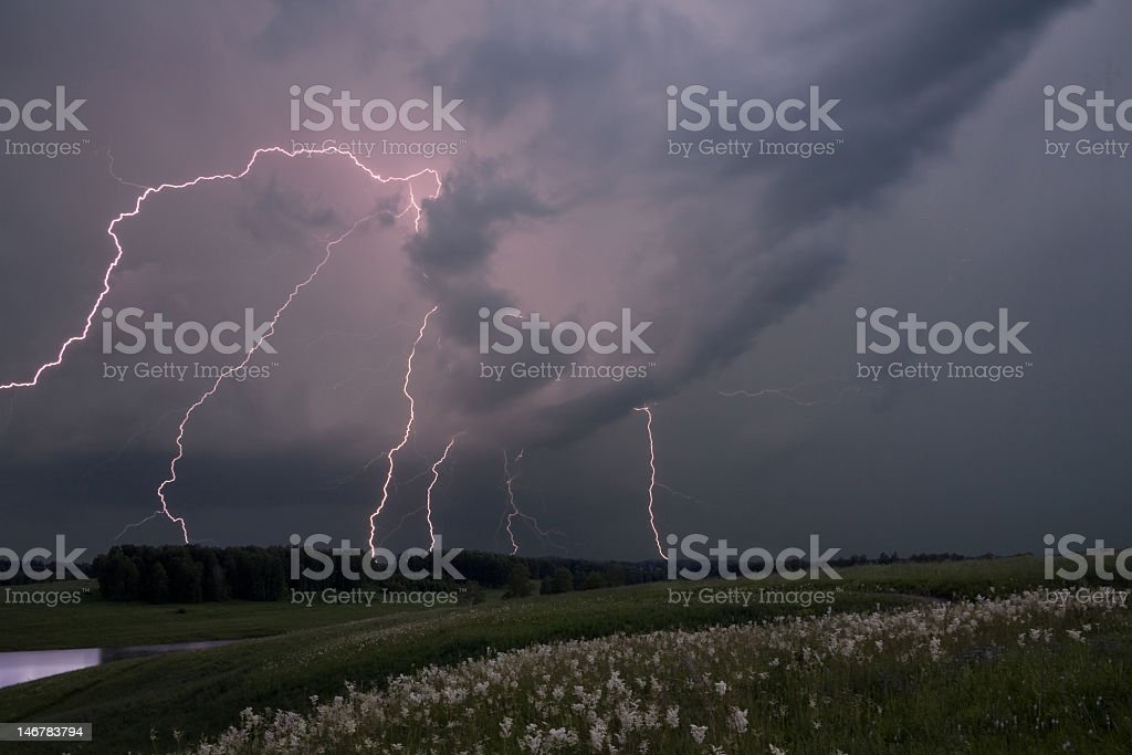 Thunderstorm in the middle of a field royalty-free stock photo