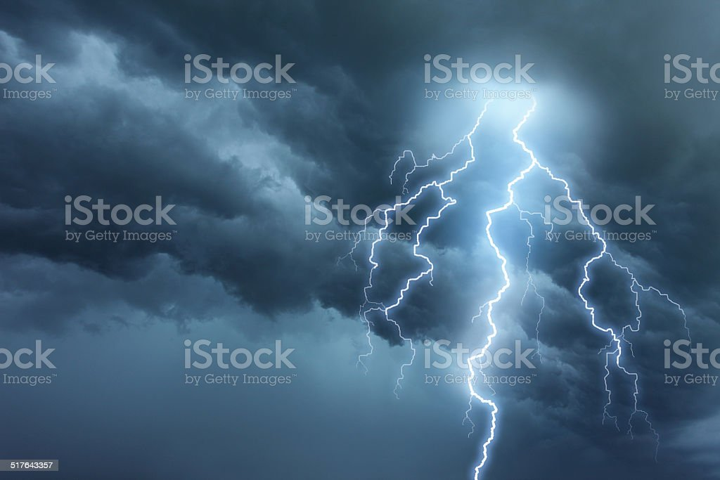 Thunderstorm lightning with dark cloudy sky stock photo