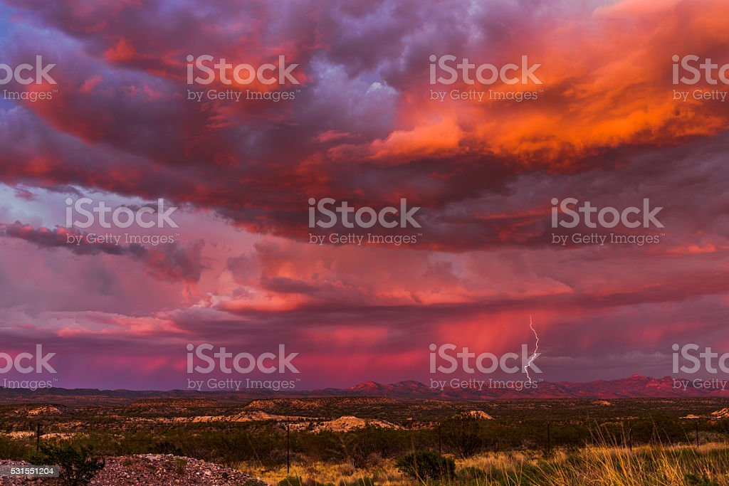 Thunderstorm lightning with sunset sky stock photo