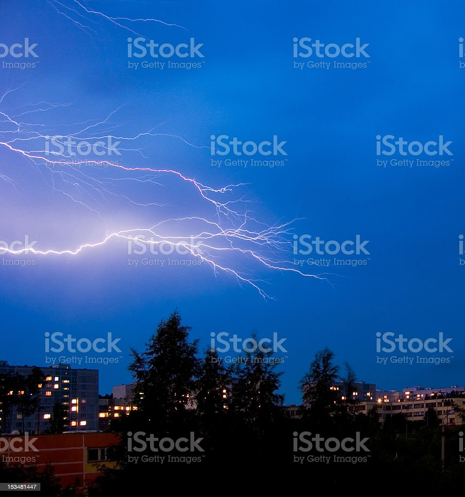 thunderstorm over a nightly town royalty-free stock photo