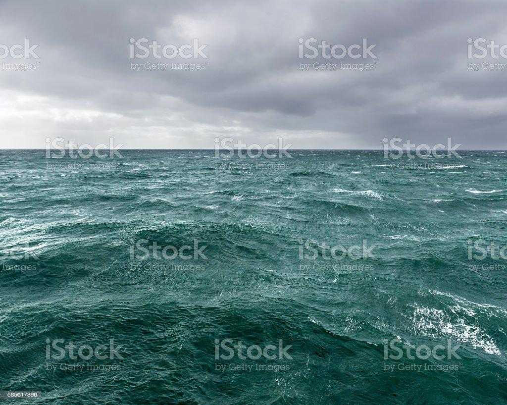 Thunderstorm over open ocean stock photo