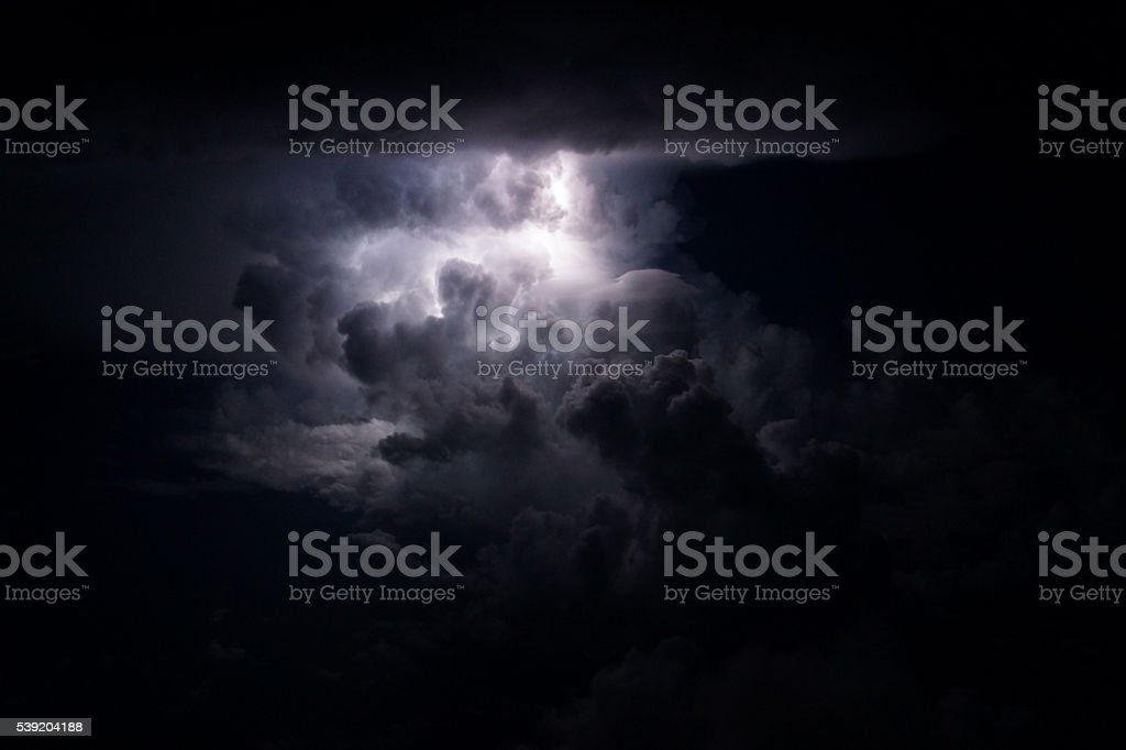 Thunderstorm over the sea with lightning bolts stock photo