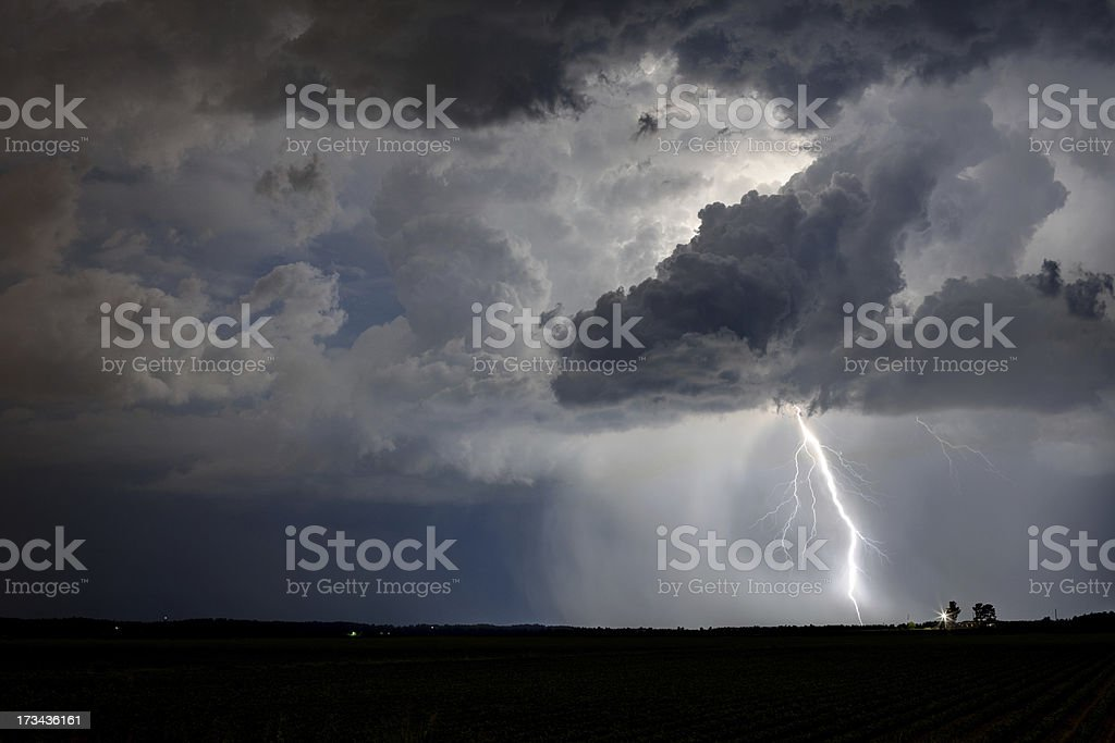 Lightning striking at night from a thunderstorm, showing heavy rain...
